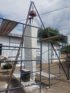 "Large marble sculpture setup with scaffolding to assist Ellza to reach the upper part of the stone. The marble started as 10' T x 30"" W x 18"" D (at it's largest end, the top)."