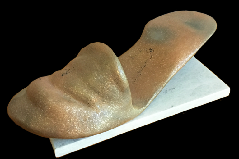 """""""Slipped Away Dreams"""". Micaceous clay w/ marble tile base. 4"""" H x 9"""" L. Available. © Ellza Coyle."""